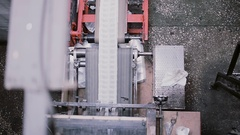 Aerial view of process of printing at a publishing establishment. Paper cut on a Stock Footage