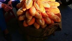 Closeup Large Heap of Vietnamese Baguettes at Street Market Stock Footage
