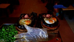 Closeup Plates with Vietnamese Dish Bone on Kitchen Table Stock Footage