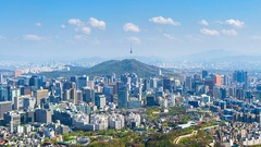 Time lapse of Cityscape in Seoul with Seoul tower and blue sky, South Korea. Stock Footage