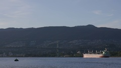 Extreme wide shot of a ship crossing the Burrard Inlet right under the Lions Stock Footage