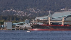 Camera Panning right following the speed boat as it crosses the Burrard Inlet Stock Footage