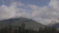 Timelapse Clouds Rolling Around Mountain Peak Stock Footage