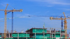 4k Time-lapse of Industrial construction crane with blue sky Stock Footage