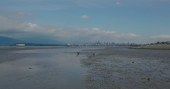 Extreme wide shot of the Vancouver shore with the city in the background. Stock Footage