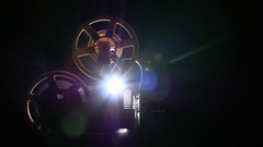 Film projector backlit from behind light lamp. Dark background studio Stock Footage