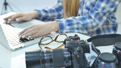 Female photographer working in her studio hands close up and digital camera on Stock Footage