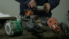 Electrical handheld devices in focus,electrician fixing rotor blurred by Sheyno. Stock Footage
