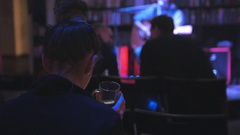 Girl in night club drink coffee at rock guitarist plays guitar for spectators Stock Footage