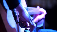 Musician in night club - guitarist plays blues acoustic guitar Stock Footage