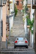 Car and high slope street with stairs Stock Photos