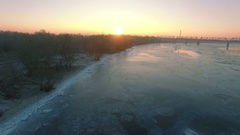 4K Aerial. Winter landscape with  frozen city river in sunrise, sunset Stock Footage