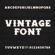Vintage typeface. Retro distressed alphabet font on a wooden background. Stock Illustration