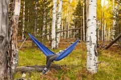 Woman relaxing in hammock, Flagstaff, Arizona, USA Stock Photos