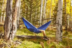 Man relaxing in hammock, Flagstaff, Arizona, USA Stock Photos