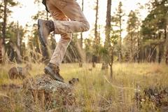 Man walking in rural setting, low section, Flagstaff, Arizona, USA Stock Photos