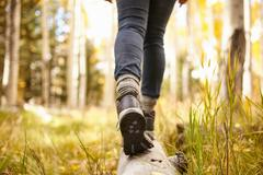 Woman walking on log, low section, Flagstaff, Arizona, USA Stock Photos