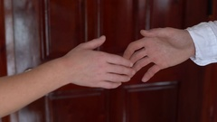 Two businessperson shaking hands; only hands to be seen and a key is be given Stock Footage