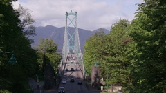 Wide shot of cars driving on the Lions Gate Bridge Stock Footage