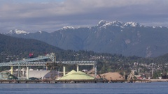 Lock down of waterfront view of the mountains in Vancouver Stock Footage