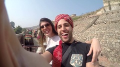 Couple talking a selfie in Elephant in Amber Fort, Jaipur, India Stock Footage