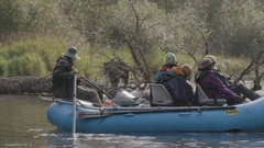 Tourists on Raft Gaze at Nearby Grizzly Bear Stock Footage