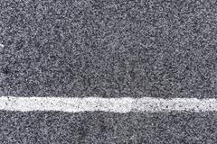 White line and asphalt road as simple urban background pattern Stock Photos