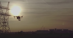 Drpne Shot of Inspire 1 Drone with sunset and electricity poles in background 6 Arkistovideo