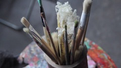 Artist's brushes and vintage fan Stock Footage