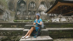 The girl in a blue dress and a skullcap at the temple. The mysterious small Stock Footage