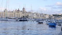 Birgu, Malta buildings architecture and yachts moored to marina quay in morning Stock Footage