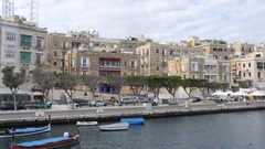 Malta embankment and beautiful buildings and boats view from moving ferryboat Stock Footage