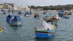 Marsaxlokk, Malta - beautiful fishing village with colored boatsat at anchor Stock Footage