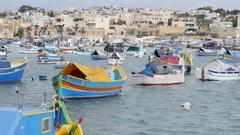 Marsaxlokk, Malta - beautiful fishing village architecture with colored boats Stock Footage
