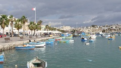 Marsaxlokk, Malta - beautiful fishing village embankment with colored boats Stock Footage