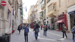 Valletta, Malta - beautiful street and buildings and people tourists crowd walk Stock Footage