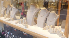 Valletta, Malta shopping - jewellery layout souvenirs behind glass frontage Stock Footage