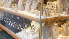 Valletta, Malta shopping - jewelry layout souvenirs behind glass frontage Stock Footage