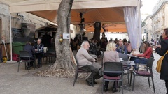 Valletta, Malta - people tourists sit rest and eat at street restaurant tables Stock Footage