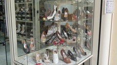 Valletta, Malta - female shopping - footwear layout in frontage of fashion store Stock Footage