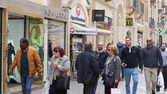 Valletta, Malta - McDonalds frontage building and people tourists crowd walk Stock Footage