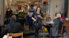 Valletta, Malta - people tourists sit rest and eat at cafe tables - interior Stock Footage