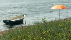 Seascape boat and umbrella Stock Footage
