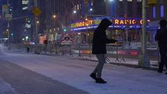 Snow Plow Removes Snow From Sidewalk Near Radio City Music Hall Stock Footage