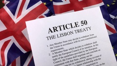 European Union and Union Jack flags with Article 50. Stock Footage