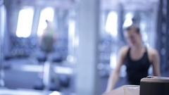 Woman smiles, comes to coffee machine, drinks protein cocktail in gym Stock Footage