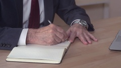 Closeup manager handwriting sits at the desk Stock Footage
