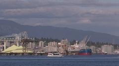 Wide shot. A boat crossing Burrard Inlet in vancouver. Stock Footage