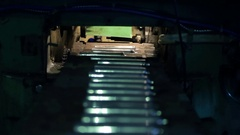 Shooting inside cylinders being delivered to conveyor belt in factory Stock Footage