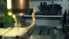 Close up drilling machine drill with holes in metal plate at factory Stock Footage